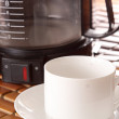 Coffee machine and cup — Stock Photo #6739464
