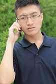 Chinese man talking phone and worry — Zdjęcie stockowe