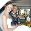 Bride and Groom in wedding car — Stock Photo