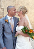 Bride and Groom's first kiss — Stockfoto