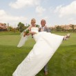 Bride and Groom in the sunshine — Stock Photo