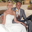 Bride and Groom in a Golf Cart — Stock Photo