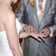 Bride and Groom in church exchaning rings — Stock Photo