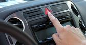Pressing emergency warning lights button — Stock Photo