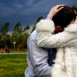 Bride and Groom Kissing  and storm sky — Stock Photo
