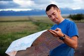 Tourist exploring the map — Stock Photo