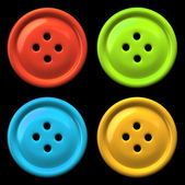 Four colourful buttons for clothing isolated on black background — Stock Photo
