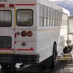 White School Bus Pumping Gas — Stock Photo