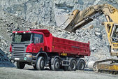 Dump Truck and Excavator in a Quarry — Stockfoto