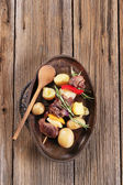 Shish kebab and potatoes — Stock Photo