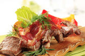 Roasted meat on wooden skewer — Stock Photo