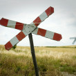 Railroad crossing sign - Stock Photo