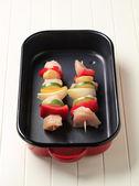 Raw chicken shish kebabs — Stock Photo