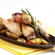 Roasted chicken drumsticks and potatoes — Stock Photo