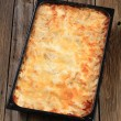 Lasagna in a baking pan — Stock Photo
