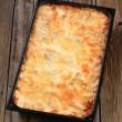 Lasagna in a baking pan — Stock Photo