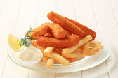 Fried fish fingers and French fries — Stock Photo