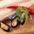Fresh fish fillet and mussels — Stock Photo #5941422