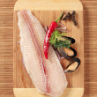Fresh fish fillet and mussels — Stock Photo