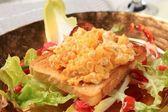 Scrambled eggs on toast and fresh salad — Stock Photo