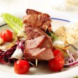 Stock Photo: Pork kebab and vegetables
