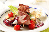 Pork kebab and vegetables — Stock Photo