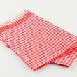 Red and white tea towel - Stock Photo