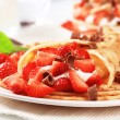 Crepes with sweet cheese and strawberries - Stock Photo