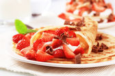 Crepes with sweet cheese and strawberries — Stock Photo