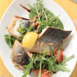 Salmon trout fillets and salad greens — Stock Photo