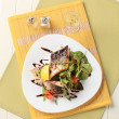 Salmon trout fillets and salad greens — ストック写真