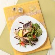 Salmon trout fillets and salad greens — 图库照片