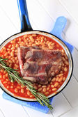 Pork ribs and baked beans — Stock Photo