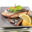 图库照片: Pan fried trout fillets