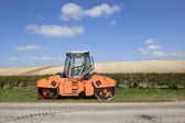 Orange road roller — Stock Photo