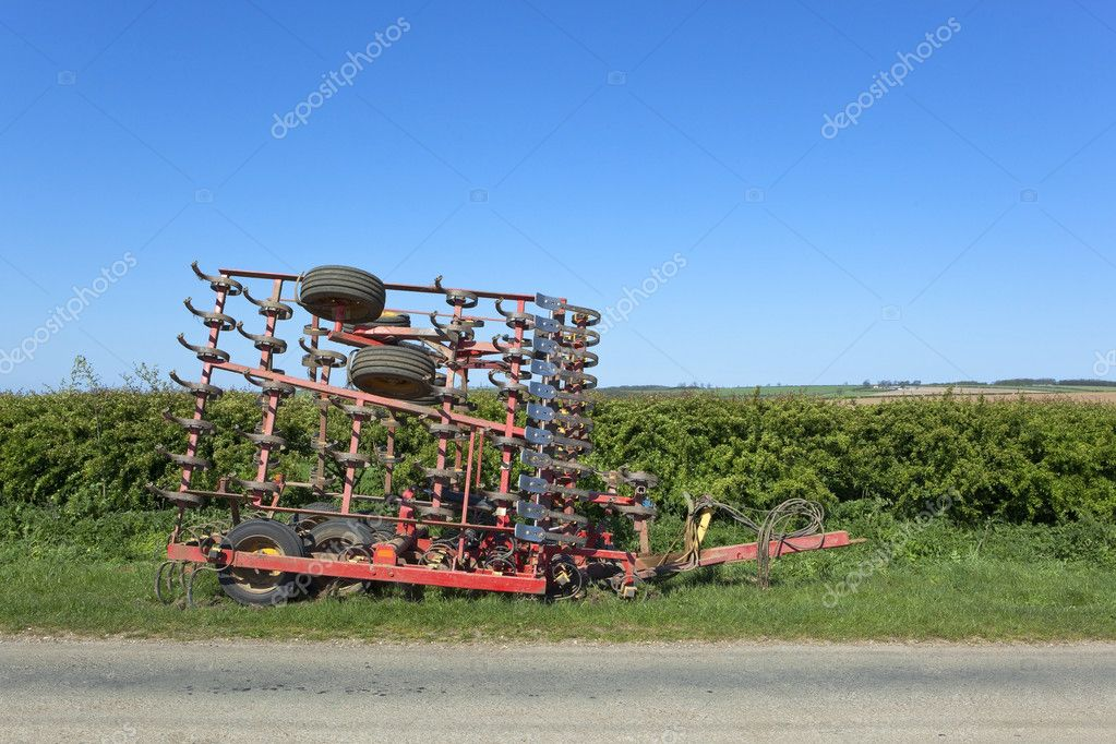 A set of portable harrows by a rural roadside under a blue sky  Stock Photo #5535627