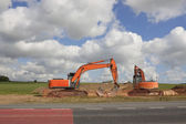 Orange diggers — Stock Photo