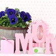 Stock Photo: Pansys and gifts for Mom
