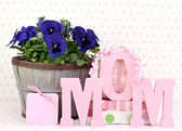 Pansys and gifts for Mom — Stock Photo