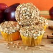 Royalty-Free Stock Photo: Stacked Apple Bran and Granola Muffins with selective focus on f