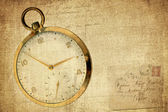 Vintage reloj sobre fondo grunge texturada — Foto de Stock