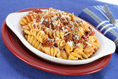 Baked spriral rotelle pasta in meat sauce — Stock Photo