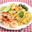 Royalty-Free Stock Photo: Barbecued Shrimp, rice curry, pineapple, peppers and lime.