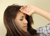 Beautiful Young Woman Holding Her Forehead — Stock Photo