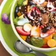 Fresh Fruit Salad with Yoghurt, Chocolate Sauce and Cereal — Stock Photo #5550520