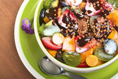 Fresh Fruit Salad with Yoghurt, Chocolate Sauce and Cereal — Stock Photo
