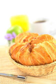 Fresh Croissants in Bread Basket — Stock Photo