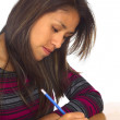 Young Peruvian Woman Writing — Stock Photo