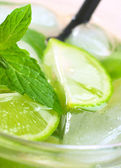 Refreshing Drink with Mint, Lime and Ice — Stock Photo