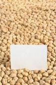 Raw White Chickpeas with a Blank Card — Stock Photo